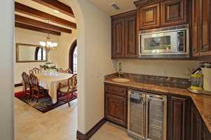 This dining area has quick access to thiskitchenette.
