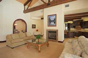 This home features vaulted, open-beam ceilings as viewed inside thisfamilyroom.