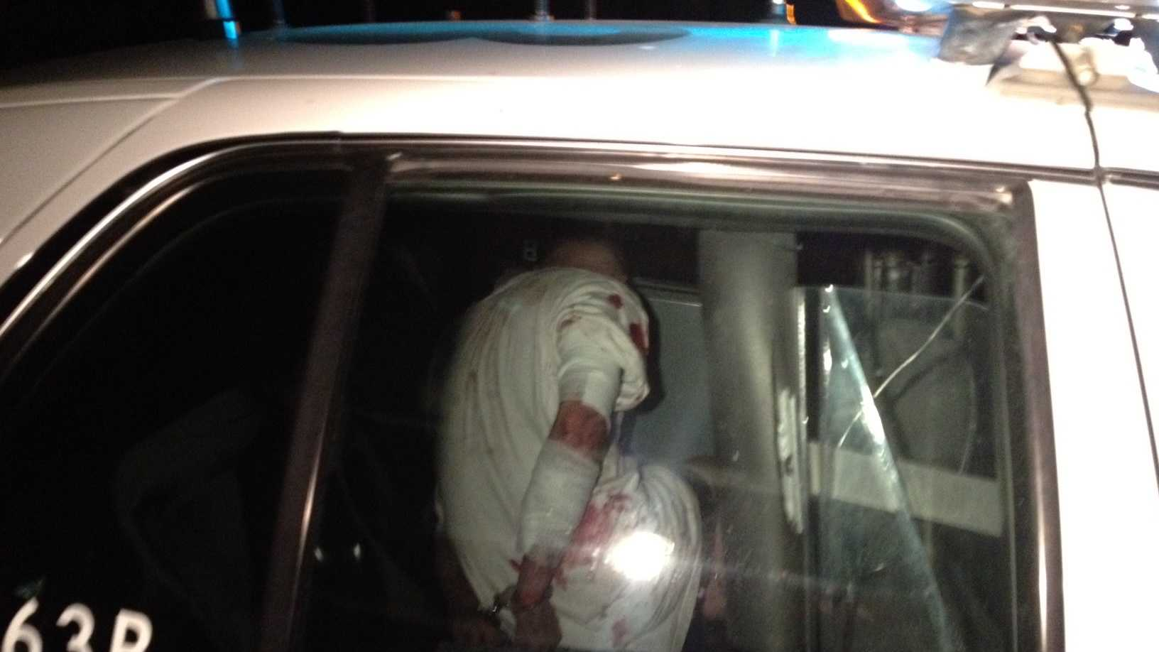 A stolen-iPad suspect in the back of a patrol car (Oct. 17, 2012).