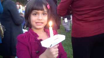 A young girl holds a candle in Stockton on Wednesday for the girl a world away. Yousufzai was targeted because of her vocal support for girls' education, and her criticism of the insurgents.