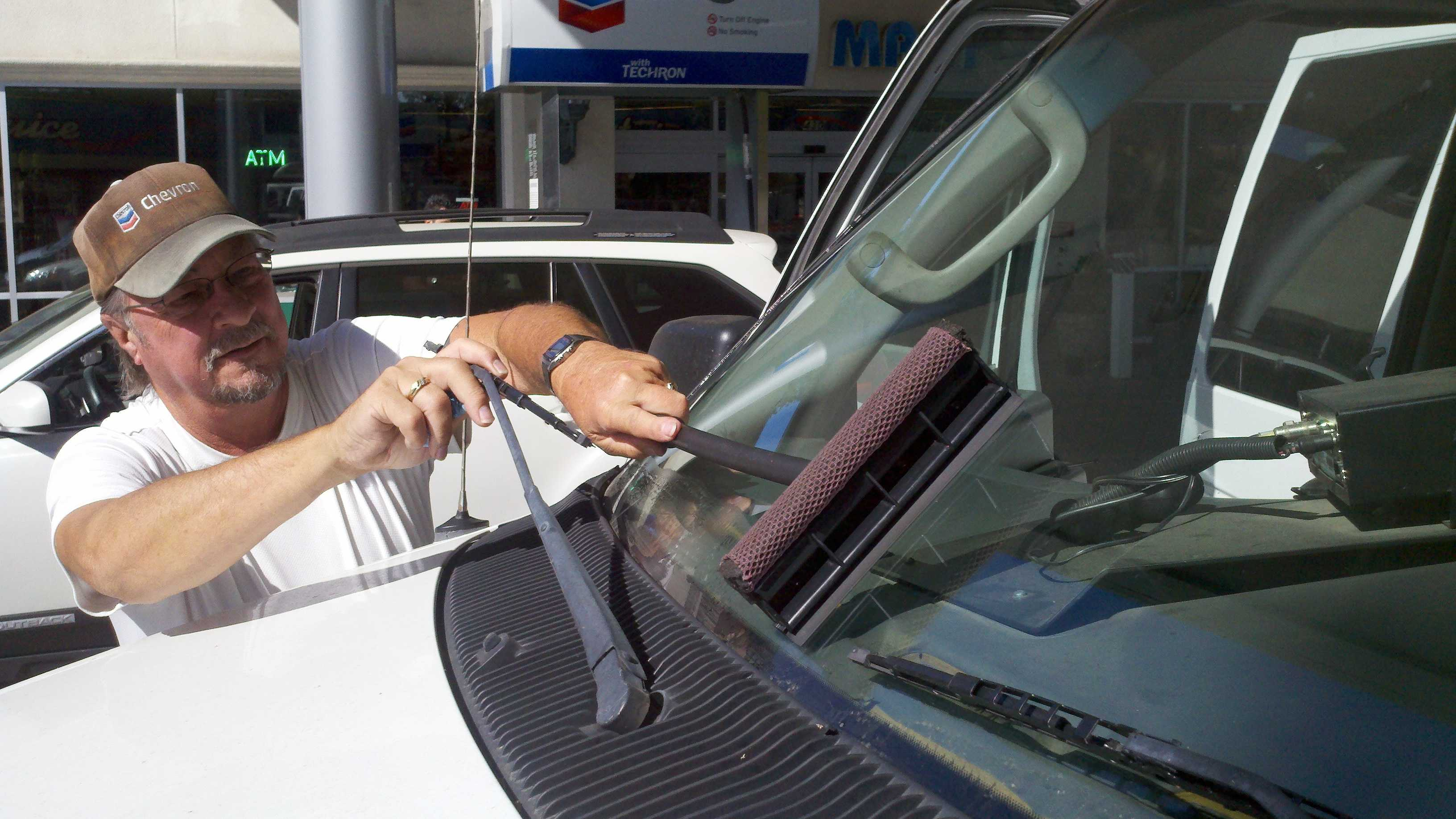 Don Kine wipes a windshield at a gas station near 29th and D streets in Sacramento.