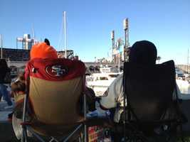 Fans enjoy theatmosphereof Game 2 in San Francisco near McCovey Cove on Thursday.