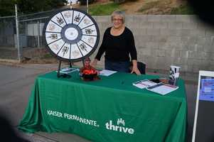"""The Kaiser booth with their wheel of """"learning to thrive""""."""