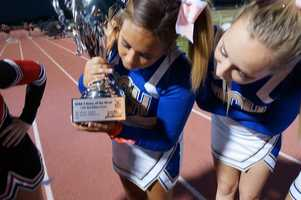 Del Campo cheer checks out the trophy.