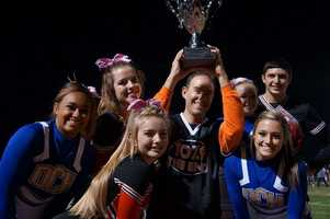 Chris K. from 107.9 the End and cheerleaders from both teams.