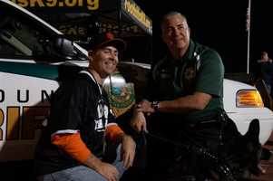 Deputy Shawn Rosner, Jet (K-9) and Christopher K. from 107.9 the End.