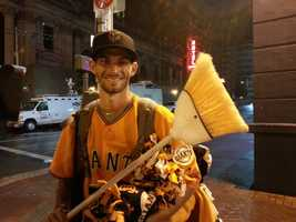 A Giants fan holds a broom, a reminder that the Giants beat theDetroitTigers 4-0.