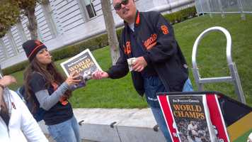 Orange-and-black clad fans begin flooding the streets of San Francisco Wednesday for a Halloween Day parade celebrating the 2012 World Series champion Giants.