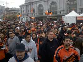 Orange-and-black clad fans begin to soak in the championship vibe in San Francisco Wednesday during a Halloween Day parade for the 2012 World Series champion Giants.