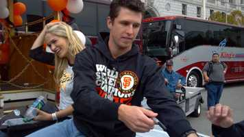 Buster Posey signs autographs during Wednesday's parade.