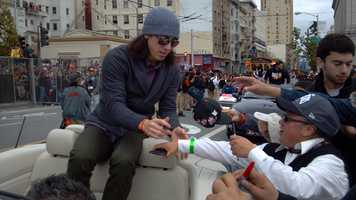 Tim Lincecum signs autographs during a parade Wednesday.