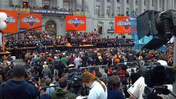 Orange-and-black clad fans began flooding the streets of San Francisco Wednesday for a Halloween Day parade celebrating the 2012 World Series champion Giants.