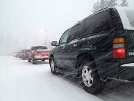 Vehicles are slowed by a downpour of snow on Interstate 80.