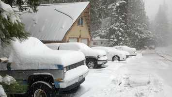 Vehicles are covered with snow in Blue Canyon on Friday.