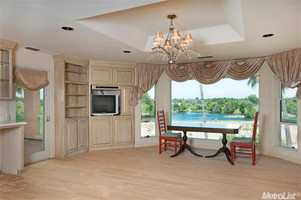 The dining nook offers a beautiful view of water.