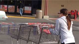 A Raley's employee in West Sacramento wheels carts back toward the store.