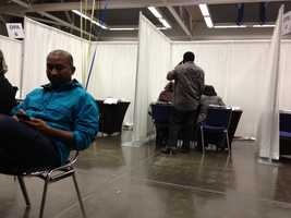 A homebuyer sits and waits to learn about a home buyers' workshop, a required 8-hour class for people who qualify for a $15,000 grant from Wells Fargo and NeighborWorks toward a down payment on a home.