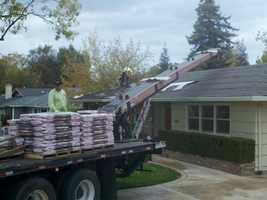 Roofing contractors hope to beat the rain on Friday.