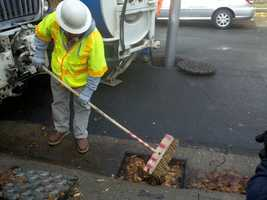 A city worker cleans out drains in Sacramento.