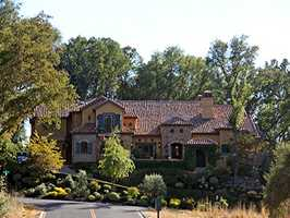 The home offers some spectacular views of the foothills and Sacramento Valley. It is also next to a golf course.