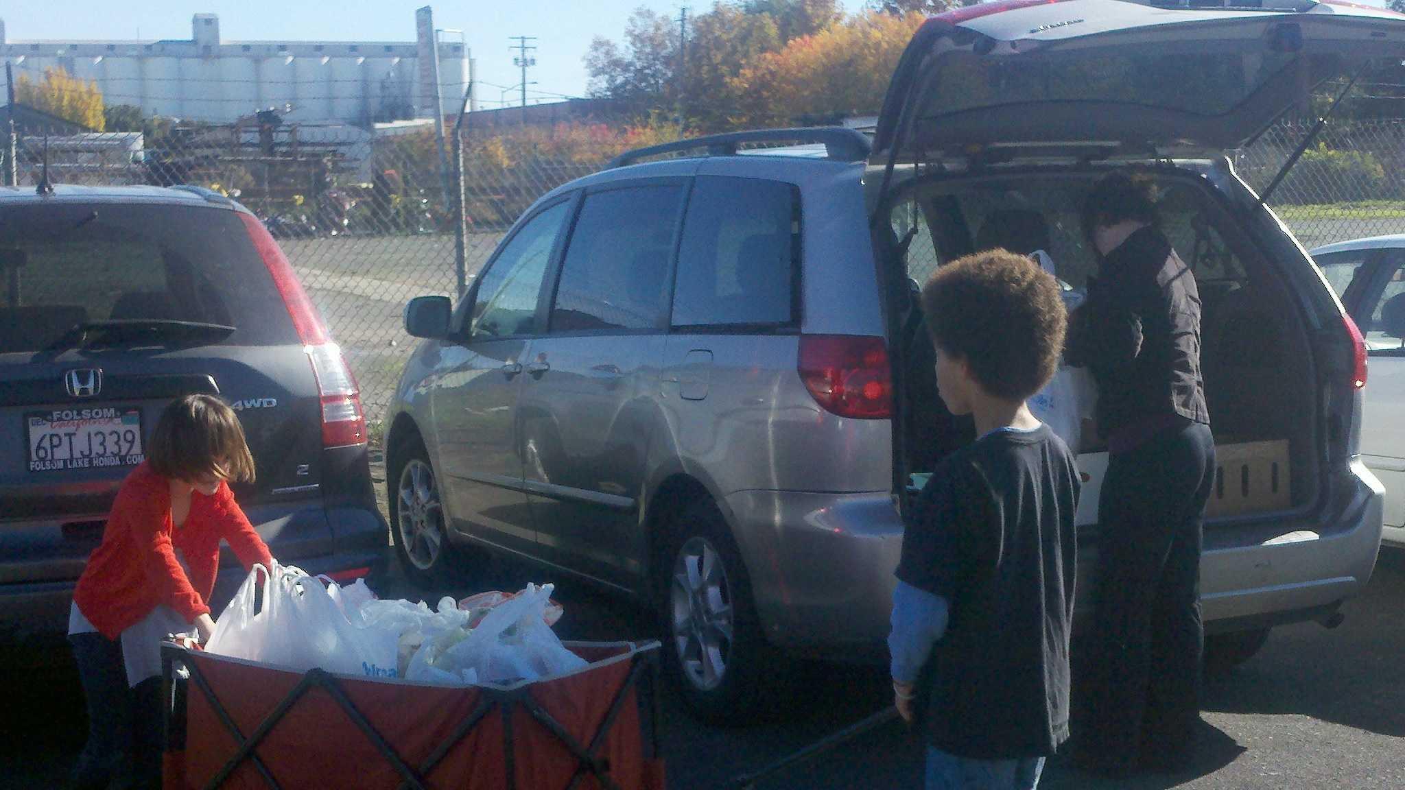 Tommy pulls wagon full of food.jpg