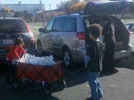 The boy got a friendly response from men and women on Thanksgiving, who gladly accepted the food and personal care items that Tommy and members of Sanctuary Covenant Church packed that morning.