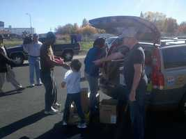 This year, Tommy, along with other children and adults, handed out more than 250 holiday bags.