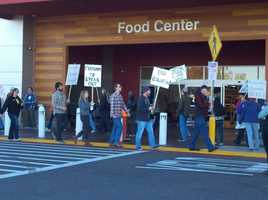 About 30 picketers stand outside a Walmart in West Sacramento on Friday to voice concerns over worker treatment.