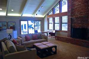 The living room features one of the home's fireplaces.