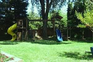 Finally, the backyard has children in mind with this classic playground. For more details on this home visit realtor.com