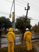 WednesdaySMUD workers assess the damage to a power line. Power was out for up to 1,400 customers.