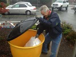 WednesdayJack Forrester grabs some free sand bags for a sidewalk that runs off into his home's back door.