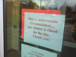 """After the shooting, this animal control facility closed its doors. This sign on the door posts this message: """"Due to unfortunate circumstances ... our shelter is closed for today."""""""