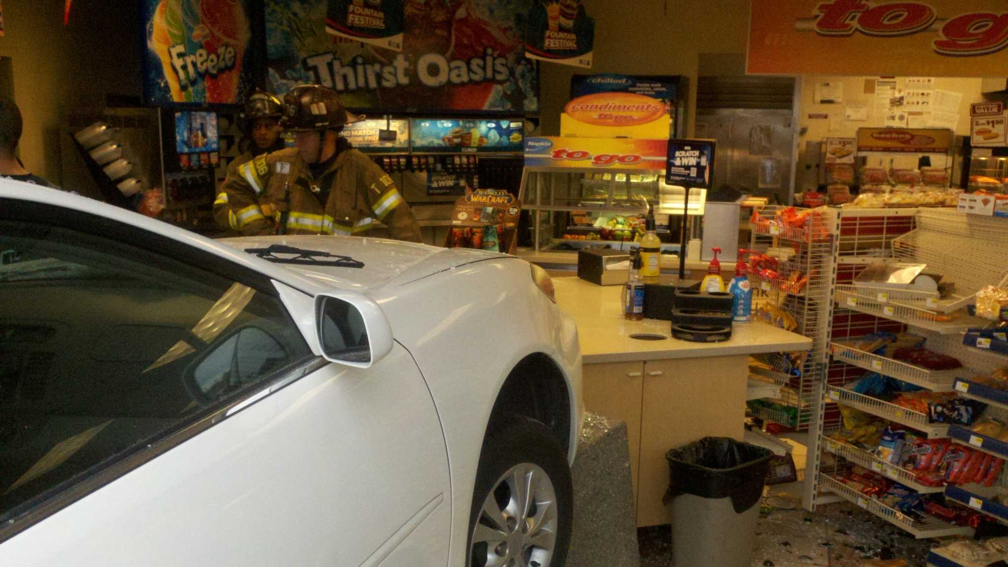 A woman crashed her car into a Sacramento AM/PM gas station on Thursday morning (Nov. 29, 2012).