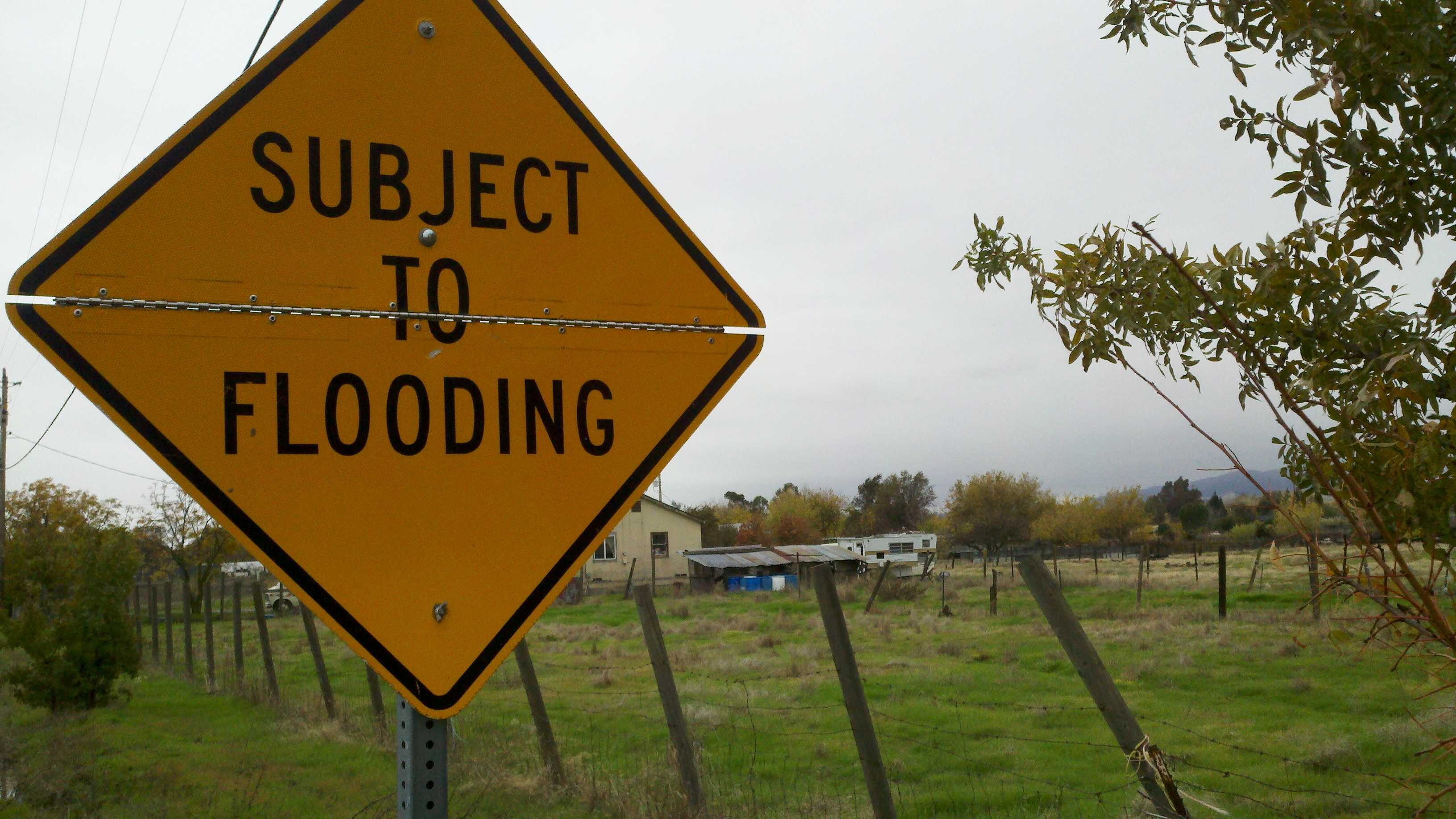 A sign in Solano County's Allendale community warns of the possibility of flooding.