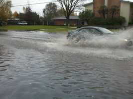 FridayA car passes through flooded road near Hurley Way and Fulton Avenue.