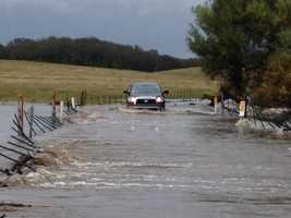 FridayA truck passes along a flooded road.