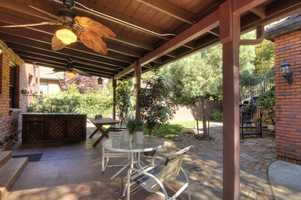 The home features a covered loggia in the backyard.