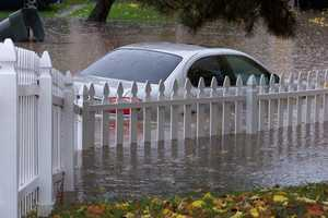SundayA car is submersed in water in this area at Shaver Court in Old Foothill Farms.