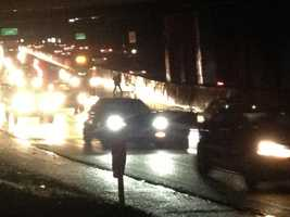 A maintenance worker tried to clear the drain along the Capital City Freeway on Wednesday morning. A Sig Alert was issued for a lane closure east of E Street (Dec. 5, 2012).