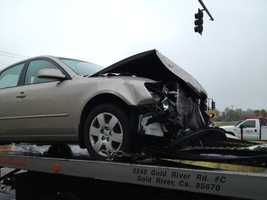 The carinvolvedin the crash had to be towed away.