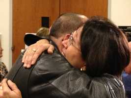 Andrea Rosenstein, Sabrina Gonsalves' sister, hugs another family member after the verdict is read.