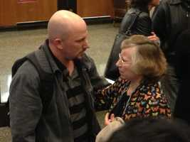 The jury foreman speaks with a member of the victims' family in the downstairs of the Sacramento County Courthouse.
