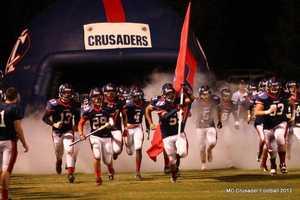 Modesto Christian Crusaders football taking the field