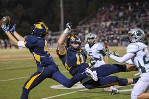 Oak Ridge Trojan football players go flying for the football.