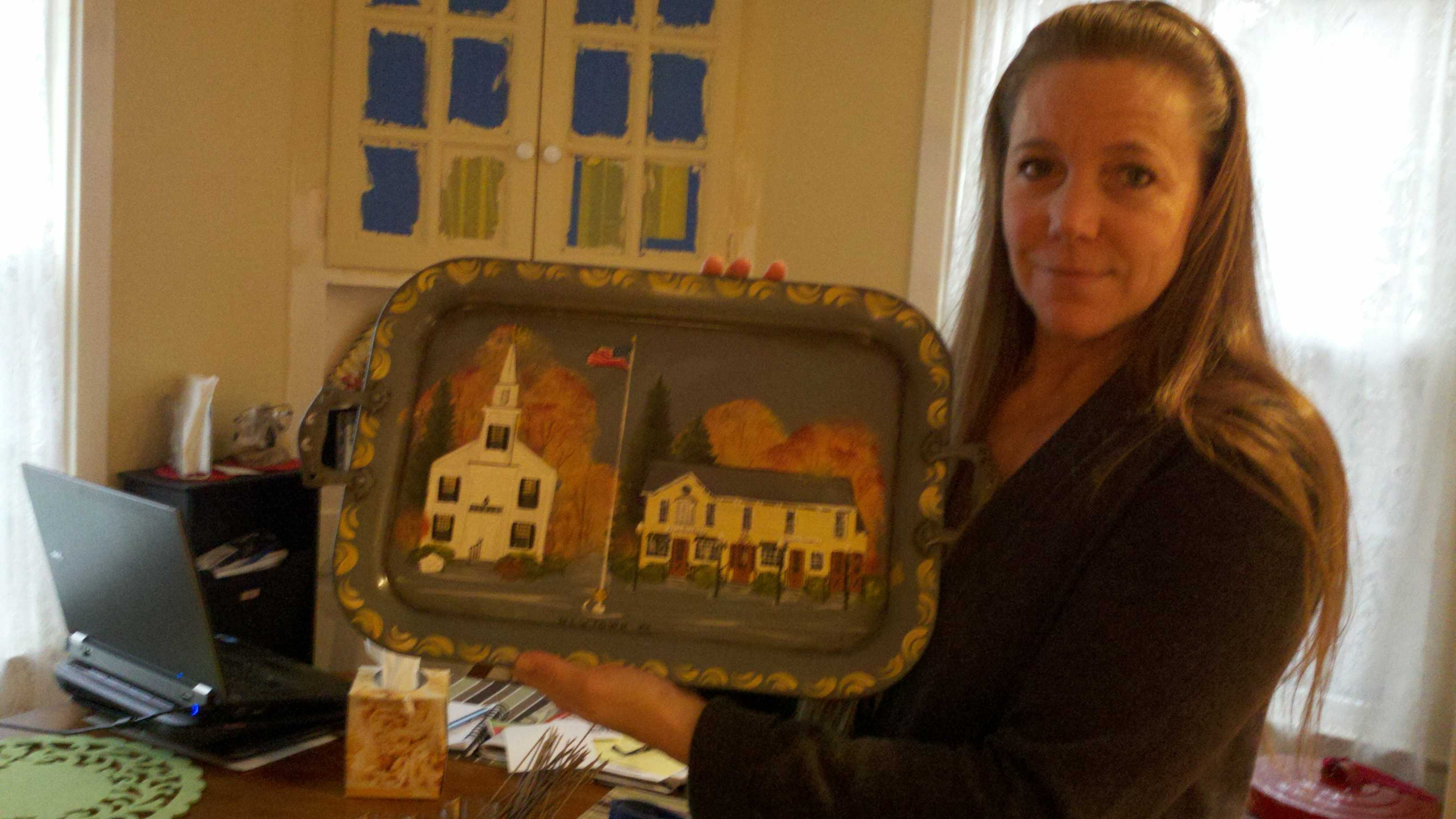 Wendy Aurelia of Stockton holds a tray painted with scenes from her hometown of Newtown, Conn.
