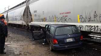A van crashed into a parked train Monday after it lost control.