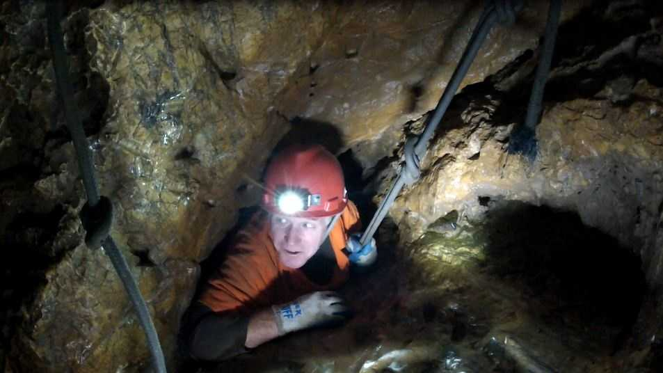 KCRA 3 photographer Mike Rhinehart feels the squeeze as he wiggles his way through one of the many challenges in Moaning Cavern.
