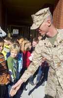 Pusley greets schoolchildren outside Hughson Elementary School.