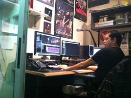 A video editor works on preparing some clips for a newscast.